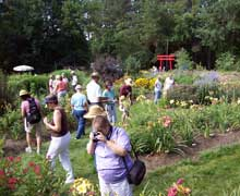 Convention visitors stroll through gardens